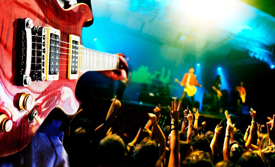 18584757 – music live background,guitar player and public
