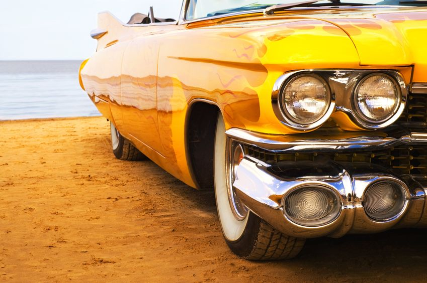4240765 – classic yellow flame painted car at beach