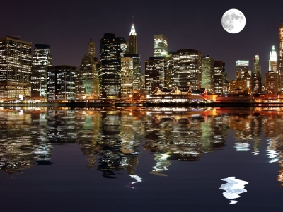 7634281 – lower manhattan in new york city at night with reflection in water